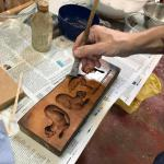 Oiling the mould